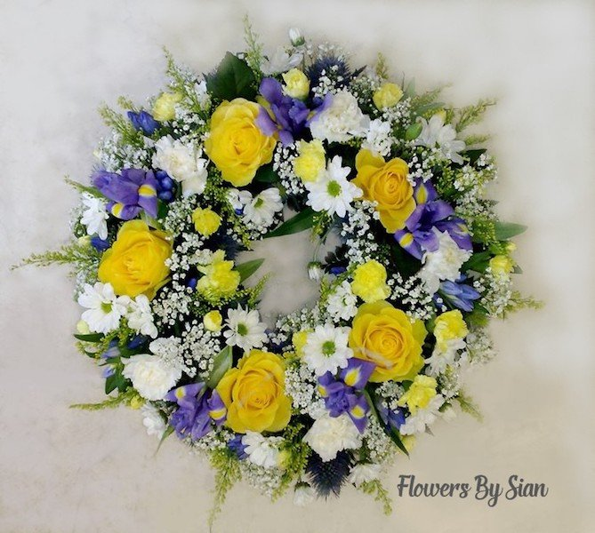 Yellow Roses Purple Ribbon Wreath