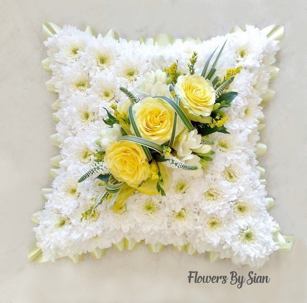 floral funeral pillow yellow roses