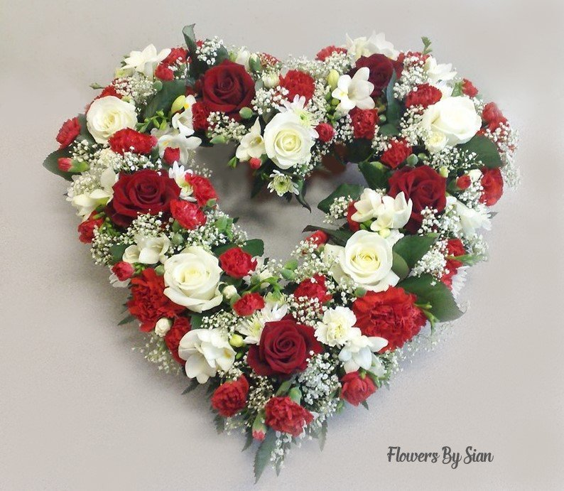Funeral flowers red white heart